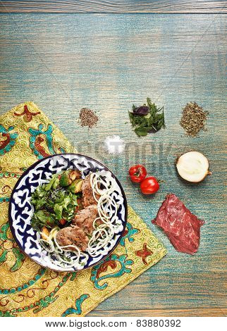 Traditional Central Asia Basturma With Ingredients On Uzbek Fabric