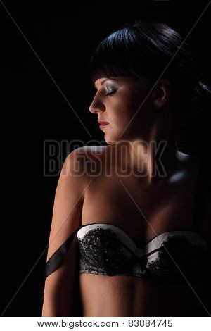 Lovely Young Woman In Lingerie Body Posing Over Dark Blue Background