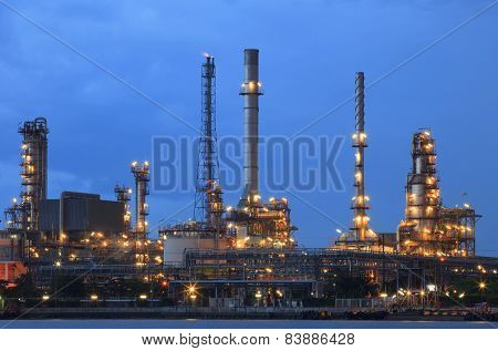 Oil Refinery Plant In Heavy Industry Estate Against Beautiful Dusky Sky Use For Petrochemical Indust