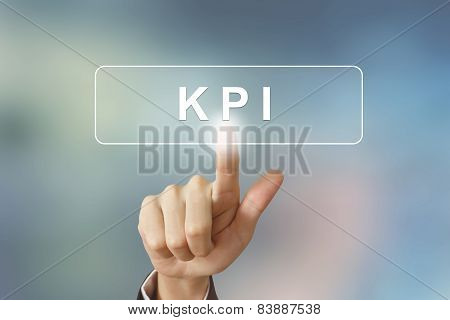 Hand Clicking Kpi Or Key Performance Indicator Button On Blurred Background