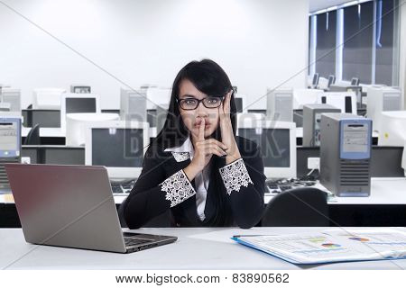 Female Entrepreneur With Silent Gesture