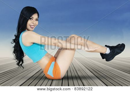 Long Hair Woman Doing Sit-up Exercise