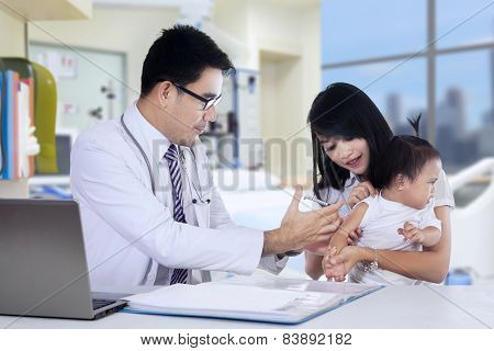 Male Doctor Inject Vaccine To Baby