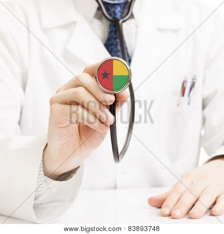 Doctor Holding Stethoscope With Flag Series - Guinea-bissau