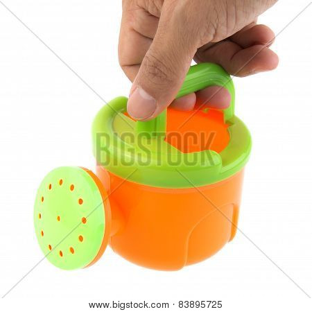 Hand Holding Watering Can
