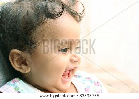 Little indian girl laughing and resting on her father