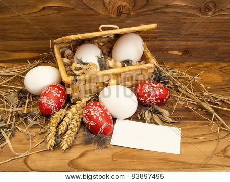 Easter Chicken Eggs In A Basket  On A Wooden Background.