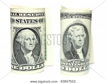 Closeup of one and two dollars isolate on white background.