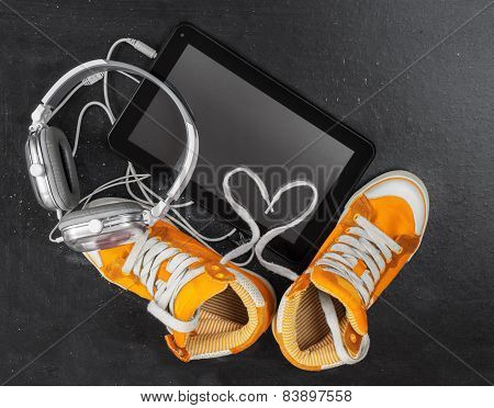 Orange Sneakers, Headphones, Tablet .