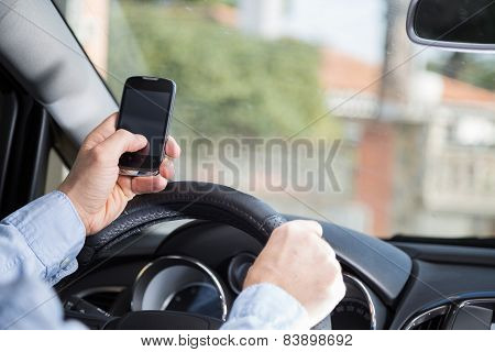 Man With Mobile And Driving