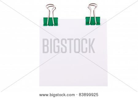 Green Paperclip With Note Paper