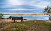 pic of mear  - Single park bench on the shores of aptly named Silver Lake - JPG