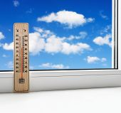 picture of heatwave  - thermometer on the windowsill on a background of clouds in the sky - JPG