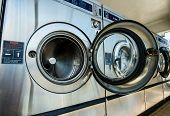 picture of time machine  - line of laundry machine in shop during business time - JPG