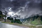 stock photo of jammu kashmir  - storm clouds over mountains of ladakh green valley sccenary Jammu and Kashmir India - JPG