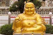 image of buddha  - Smiling Golden Buddha Statue  - JPG