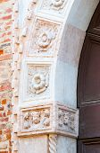 picture of vicenza  - Ornamental stone sculpture details of a door in Contr - JPG