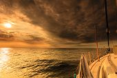 stock photo of yacht  - Yachting yacht sailboat sailing in baltic sea at sunset sunrise summer vacation - JPG