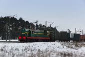 picture of railroad car  - the powerful cargo train with a set of heavy cars is lucky freight - JPG
