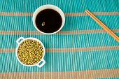 picture of soy sauce  - Soy sauce and soy beans on a bamboo mat - JPG