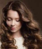 stock photo of flowing hair  - Young Woman with Brown Hair in Reverie - JPG