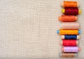 picture of sewing  - Copyspace image with sewing threads on linen - JPG