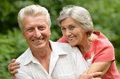 foto of elderly  - Portrait of a happy elder couple in summer - JPG