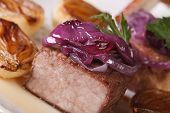 stock photo of red meat  - Tasty meat with caramelized red onion on a white plate macro - JPG