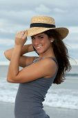 stock photo of beautiful brunette woman  - Beautiful Young Brunette Woman in Straw Hat at the Beach - JPG