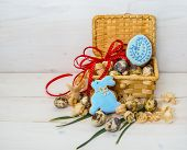 stock photo of quail egg  - Biscuits Easter Bunny and egg in a basket of quail egg on wooden background - JPG