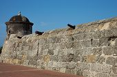 stock photo of fortified wall  - Fortified wall built to defend the historic Spanish colonial city of Cartagena de Indias in Colombia - JPG