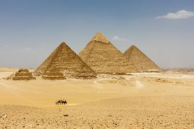 stock photo of domination  - The Pyramids plateau is dominated by the massive pyramids of Khufu  - JPG