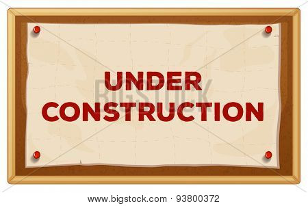 Under construction sign in the wooden frame