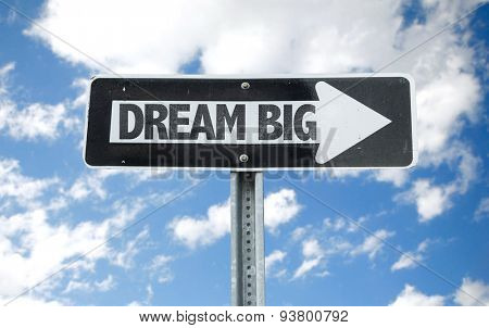 Dream Big direction sign with sky background