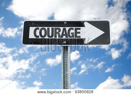 Courage direction sign with sky background