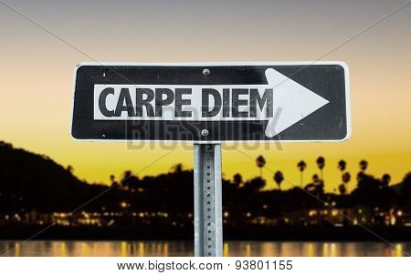 Carpe Diem direction sign with sunset background