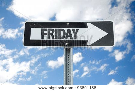 Friday direction sign with sky background