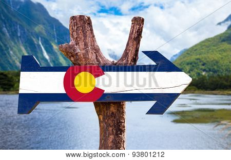 Colorado Flag  wooden sign with mountains background