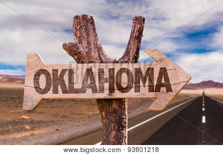 Oklahoma wooden sign with desert road background