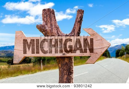 Michigan wooden sign with road background