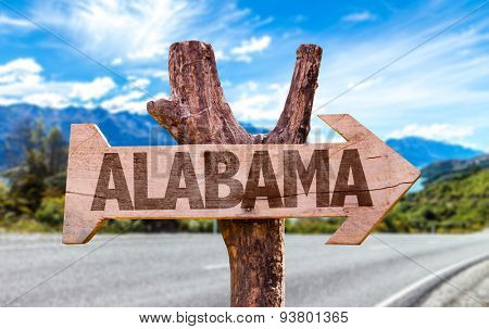 Alabama wooden sign with road background