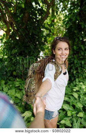 Smiling female backpacker
