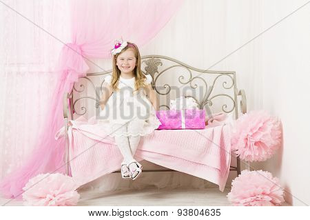 Kid Little Girl Portrait, Smiling Child Four Years With Pink Present Gift Box In Decorated room