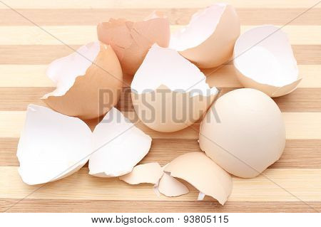 Closeup Of Cracked Eggshell On Wooden Background