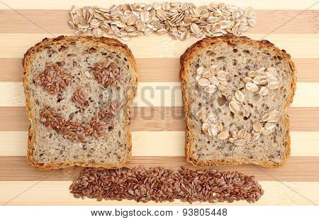 Linseed And Oatmeal On Cutting Board And Slices Of Wholemeal Bread