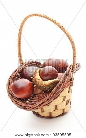 Chestnut With Crust In Wicker Basket On White Background