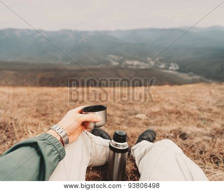 Pov Image Of Traveler With Thermos