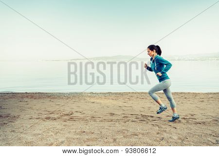 Girl Running On Coastline