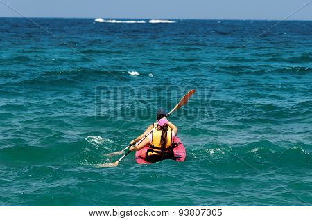Two Canoeists In The Ocean