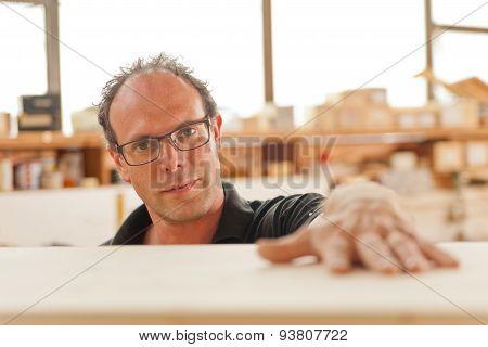 Carpenter In His Joiner's Workshop
